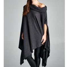 New Cherish Cowl Neck Poncho Loose fit with a large cow neck collar, this poncho is an asymmetrical hemmed tunic with slit armholes. This tunic is made with medium weight brushed fabric that has a very soft fuzzy texture, drapes well and is soft. This fabric has good stretch. Wear over leggings or a flair pants for a fun, flirty, and look that flows. Can be worn off the shoulder or cowled in the front. Very versatile!!!  Made in: United States  Fiber Content: 67% polyester, 29% rayon, 4%…