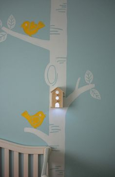 love this nursery and the tree mural with birdhouse!