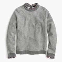"The layered-sweatshirt look with zero effort (or added bulk). We think the metallic ruffles peeking out make it even more irresistable. <ul><li>Slim fit.</li><li>Body length: 23"".</li><li>Cotton.</li><li>Dry clean.</li><li>Import.</li></ul>"