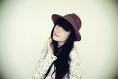 white lace and brown hat