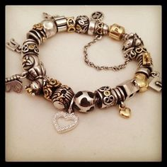 We love the black, silver and hints of #gold in this #Pandora bracelet! To purchase Pandora products, please call us at (877) 800-9998!