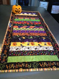"A little Halloween fun.  Table runner pattern from Fons & Porter ""Quilting Quickly"" Fall 2014."