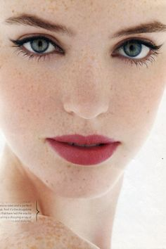 Berry lips. Winged eyeliner