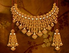 Browse through the world of Utsava by Tanishq! Explore beautifully crafted Utsava Jewellery designs online for women. Gold Mangalsutra Designs, Gold Earrings Designs, Gold Jewellery Design, Dubai Gold Jewelry, Gold Designs, Diamond Jewellery, Necklace Designs, Bridal Jewellery Inspiration, Bridal Jewelry Sets
