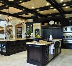 LOVE. Want double island. Our favorite kitchen. Would want to change islands a bit. Bigger sink, seating around island and more counter top overhang. Still stone wall or accents somewhere??
