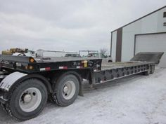 Our featured trailer is a 2002 Trail King 48 x 102 Drop Deck Trailer, Air Ride Suspension, 255/70R22.5 Tires, Fixed Axle, Steel Disc Wheels. Check out this week's recently added trailers at http://www.nexttruckonline.com/trailers-for-sale/All-Categories/All-Makes/All-Sizes/results.html?days_old-max=7