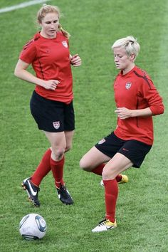 Rachel Buehler (left) and Megan Rapinoe attend the USA team training  session at FIFA c3b7f8333a