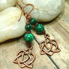"Superb green malachite gemstones are mixed with warm antique copper in these tribal inspired earrings I have named ""Celtic Love"".  Malachite is always green, usually in banded tones varying from very"
