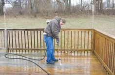 Composite decking installed prior to 2000 may have a mildew growth problem. Here we show you how to clean and seal the right way. Deck Design Plans, Deck Plans, Cool Deck, Diy Deck, Building Exterior, Building A Deck, Deck Cleaning, Gutter Cleaning, Deck Cost