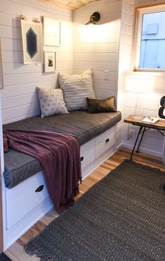 This is a 28′ Kootenay Tiny House on Wheels built for a family by TruForm Tiny. It features a private loft bedroom with 4′ ceilings accessible via a custom-built, low-footprint staircas…