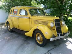Vintage Yellow Ford Taxi Cab (1935)