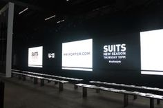 When the stage—or runway—is a central element of an event, a backdrop can call attention to something in a big way. The producers of USA Network's fashion presentation in New York on June 12 utilized the 60-foot-long LED video wall that served as the main decorative element of the catwalk to display its hashtag as well as the premiere date of show Suits.