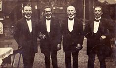 """The first usage of the term """"tip"""" in the sense of giving a gratuity dates back to 1706. Pictured here are European waiters from the early 1900s."""