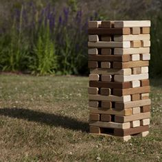 Mixed wood jenga wedding games. and when it gets boring light it on fire