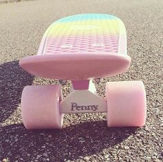 skateboard pink and blue sky and yelllow eye