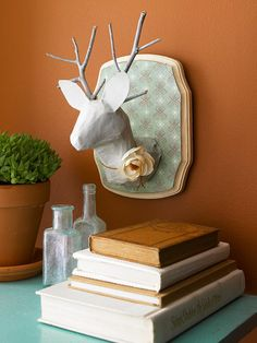 Crafty taxidermy tutorial from @Better Homes and Gardens. Use newspaper, a plastic foam egg, a water bottle and twigs to create this cruelty-free and inexpensive deer head.