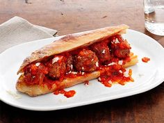 Homemade tomato sauce and veal meatballs are topped with fresh Parmesan that combine to make one heroically delicious Meatball Sub.