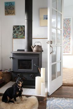 love this wood stove  Surf 'N Turf: S.F.'s Coolest Artist Couple Shows Off Their Beachside Crib #refinery29