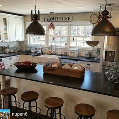 Farmhouse Kitchen. Love the wooden container on island for plates & utensils.