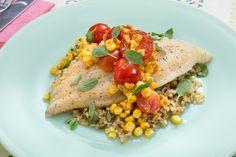 Crispy Catfish & Freekeh with Corn-Cherry Tomato Sauté & Marjoram. Visit https://www.blueapron.com/ to receive the ingredients.