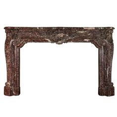 18th Century Original Belgian Marble Fireplace Louis XIV Period;   made in the Belgian Marble de Rochefort, affiliated with abbey de Rochefort, well known for its famous Belgian Beer. It is an exceptional mantel from a Belgian palace.