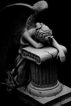 Classical sculpture in black and white of an angel