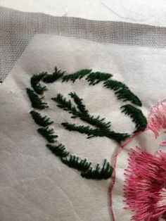 Hand stitched needle painting. Rose worked with stabilizer for a hankie.StitchbyRachel
