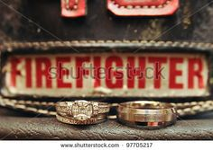 Wedding Rings On Firefighters Hat Stock Photo (Edit Now) 97705217 Fireman Wedding, Firefighter Wedding, Firefighter Love, Engagement Shoots, Engagement Photography, Wedding Engagement, Wedding Photography, Country Engagement, Engagement Ideas