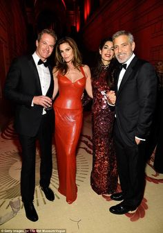 A-listers: They partied alongside good pals Rande Gerber and Cindy Crawford, (first and second left). at the Met Gala, where Amal appears to have got changed halfway through