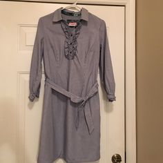Reduced!!! Lilly Pulitzer pinstripe shirt dress Lined, cotton, 3/4 sleeve shirt dress with dash that ties around the waist. Ruffle detail at button placket. Side-zip. Ruffle and button detail at sleeve. Great condition Lilly Pulitzer Dresses