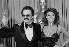 Giorgio Moroder (with Raquel Welch) winning the Oscar for the Midnight Express score in 1979
