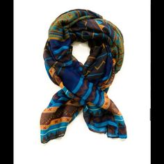 """Unique Print Scarf - Blue This unique multi-colored scarf will have any outfit looking fabulous. Scarf features: Unique print Lenght: 60"""" long Private Label Accessories Scarves & Wraps"""