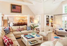 Summer home on Cape Cod. Caroline collaborated with Robin Violandi on the project and the pair created spaces that feature a neutral palette interspersed with pops of color such as the nautical navy and red accents in the living room and a rich, blue hue on the base of the island in the kitchen. The wall color in the family room is BM Manchester Tan and the wall...
