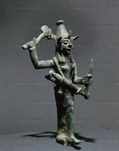 Deity. Bronze statuette (18th-17th BCE) from Syria Louvre Museum  Phoenician culture