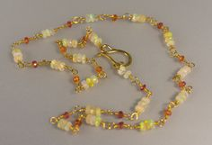 Ethiopian Welo Opal and Ruby Beads on a 18k Yellow Gold Wire Wrapped Rosary Chain Necklace