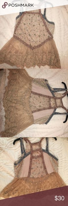Very cute top!!! Sheer bottom. Very detailed and it has a lot of different material Tops Tank Tops