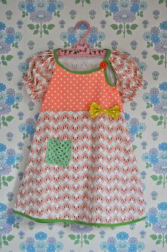 Darling dress.  Love the granny square pocket.     DSC_0012 by Smilerynker, via Flickr