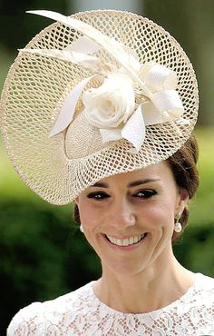 Kate Middleton, in white lace and white mesh feathered fascinator hat by Jane Taylor.  Attending Royal Ascot with Prince Willian  wore Dolce & Gabanna .....Uploaded By  www.1stand2ndtimearound.etsy.com