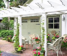 One of the biggest impacts you can make to a refreshed garage has little to do with the garage itself: Add containers potted with pretty blooms. The planters help to soften the edges between structure and landscape and add pops of visual interest to what is often a neutral facade. Here, miniature trellises up the columns add even more growing spots, with delicate vines that clamor up toward the pergola. Another idea: Use hanging baskets on either side of a garage's door.
