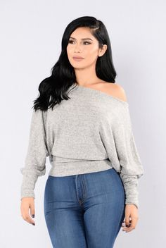- Available in Heather Grey, Olive, and Camel - Off Shoulder Sweater - Soft Material - 3/4 Sleeves - Loose Fit - Made in USA - 74% Rayon 21% Polyester 5% Spandex