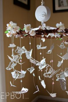 Sweet DIY butterfly mobile.                          Without the flowers or wood making the butterflies w brightly colored paper