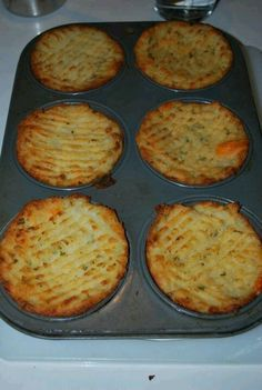 BAKED MASHED POTATOES - I cooked extra potatoes when I cooked mashed potatoes. I then put them in a covered dish in the fridge. The next day, I added sour cream, onion and garlic powder, chives, and shredded cheese. I mixed it all together, then put it in a non stick muffin pan.