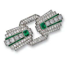 EMERALD AND DIAMOND DOUBLE CLIP/ BROOCH,  1930S.  Designed as a stylised tied bow, set with circular- and single-cut diamonds, step- and calibré-cut emeralds, mounted in gold and platinum, French assay and maker's marks.