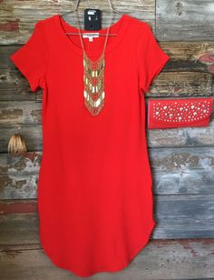 The Fun in the Sun Tunic Dress in Red is comfy, fitted, and oh so fabulous! A great basic that can be dressed up or down! Sizing: Small: 0-3 Medium: 5-7 Large: 9-11 True to Size with a Stretchy, Fitte