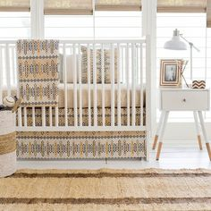 This tribal aztec baby bedding is sure to bring a bohemian feel to your nursery!  Our Navajo in Gold Crib Collection is made of neutral colored fabrics and feat