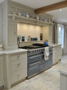 Grand cooker, bespoke kitchen in a family home by Churchwood Design
