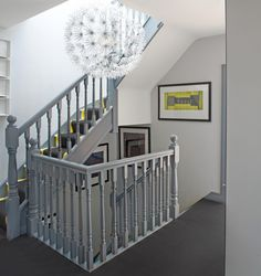 Don't automatically plump for white (although this won't fail to shine). Instead, try a sophisticated, all-over grey hue instead, choosing subtly different shades for surrounding walls and floors if you're going the whole hog. And do remember to use tough, durable paint specifically intended for wood on the banisters, so you can clean them easily.