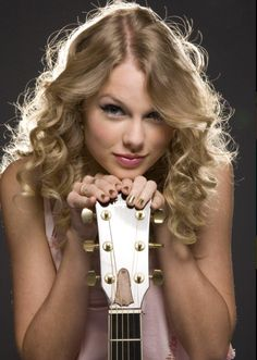 Taylor Swift! I love that pose with her guitar