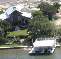 FSBO Marble Falls TX - Lake LBJ In Prestigious, Gated Wilderness Cove - Our home on about 1/2 ac. is located in secluded, gated Wilderness Cove (the best kept secret near Marble Falls) on constant level Lake LBJ. It is a unique post/beam/truss built home that includes spalted Pecan cabinetry, Cyprus ceiling/walls/trim and knotty Pine interior doors. The home designs allows separate bedroom suites in the main home for privacy and also incorporates a self contained full garage apartment...
