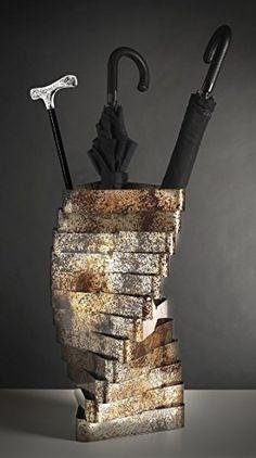 Torque. Portaombrelli in metallo ossidato.